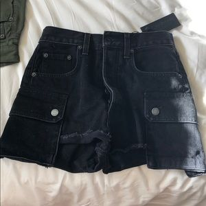 Black jean shorts with pockets on the side